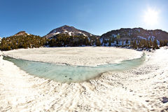 Crater lake with snow on Mount Lassen Royalty Free Stock Images