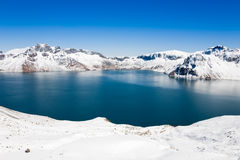 Crater Lake and snow mountain Stock Images