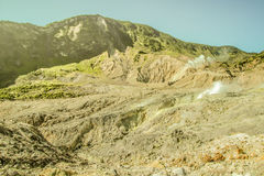 The Crater of Mt. Papandayan Emits Smokes. Mount Papandayan, West Java, Indonesi Stock Photos