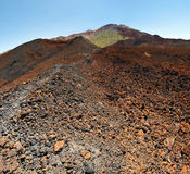 Crater of Pico Vieho hiding Teide Mount. Details of the volcanic slope and craters of Pico Vieho situated in west of Teide Mount national Parc, Tenerife Island royalty free stock image