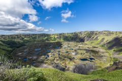 The crater of the Ranu Kau volcano with rainwater stock photo