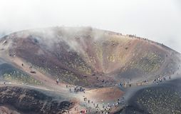 Crater Silvestri Inferiori 1886m on Mount Etna, Sicily, Italy. Unrecognisable people walk on the Crater Silvestri Inferiori 1886m on Mount Etna, Etna national stock photography