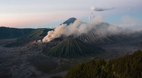 Crater of the volcano Bromo at sunrise. The first lights of the day begin to illuminate the crater of Mount Bromo Royalty Free Stock Photography