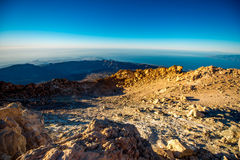 Crater of volcano Tide. Beautiful scenic view on the crater of volcano Teide with Atlantic ocean and Tenerife island on the background Stock Photo