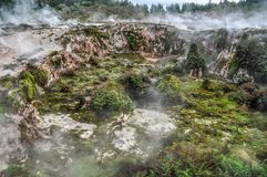 Craters of the Moon. The Craters of the Moon COM geothermal walkway wanders through a weird, other-worldy, landscape featuring bubbling craters and steaming stock image