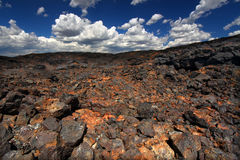 Craters of the Moon National Monument. Volcanic rock stretches into the landscape at Craters of the Moon National Monument of Idaho Stock Image