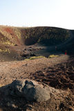 Craters Silvestri of the Etna. Tourists on the border of craters Silvestri of the Etna in Sicilia stock photo