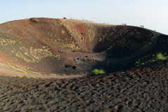 Craters Silvestri of the Etna. Tourists on the border of craters Silvestri of the Etna in Sicilia stock image