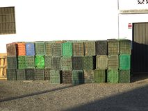 Crates against wall at local winery, Andalusia. Plastic crates stacked against wall ready for local wine harvest in Andalusia stock photo