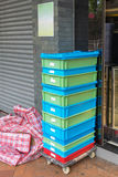 Crates at Dolly. Plastic Crates Shipping Delivery at Dolly Cart Stock Photo