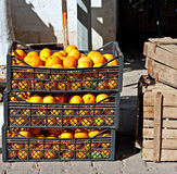 Crates of oranges at street market Royalty Free Stock Photo