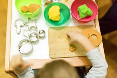 Crative boy in his workshop. Creative kid playing with playdough Stock Images