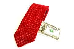 Cravate et argent rouges Photographie stock