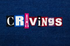 CRAVINGS word text collage, multi colored fabric on blue denim, uncontrollable urge concept