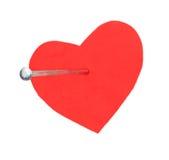 Cravo em um coração vermelho fotografia de stock