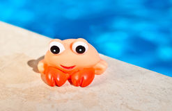 Craw fish toy near the pool Royalty Free Stock Photo