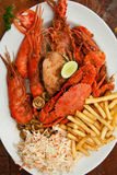 Crawfish with fries Stock Photos