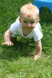Crawl. Happy boy makes people younger and makes them smile Royalty Free Stock Photos