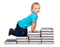 Crawl for education. A toddler crawl for education represented by a conception steps made of books Royalty Free Stock Photography