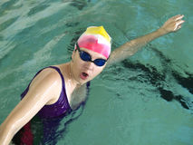 Crawl swimmer. Woman with open mouth royalty free stock images