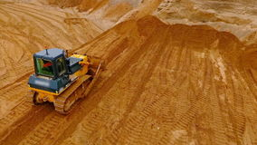 Crawler bulldozer standing at sand mine. Construction machinery at sand quarry stock video footage
