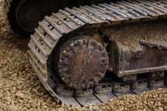 The Crawler close up , muddy crawler chain detail in earthy ambi. Ance, Well used excavator tracks closeup Royalty Free Stock Photos
