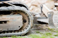 The Crawler close up , muddy crawler chain detail in earthy ambiance. Well used excavator tracks closeup Royalty Free Stock Photos