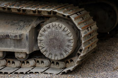 The Crawler close up , muddy crawler chain detail in earthy ambiance, Well used excavator tracks closeup. Laos Royalty Free Stock Photos