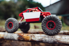Crawler driving on wooden beams side view Royalty Free Stock Image