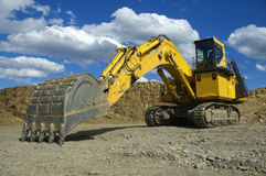 Crawler Excavator. Side view of an excavator for coal mine open pit, with chains royalty free stock photo