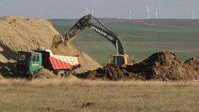 Crawler excavator depositing soil into trucks, time lapse. TULCEA, ROMANIA - NOVEMBER 08: Crawler excavator depositing soil into trucks, time lapse on November stock video footage