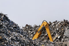 Crawler excavator lost in metal scrap Royalty Free Stock Photos