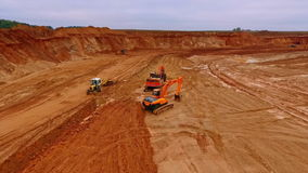 Crawler excavator standing in sand quarry. Aerial view of sand mining in quarry. Crawler excavator standing in sand quarry. Tractor driving through sand pit stock video