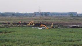 Crawler excavators at work stock video
