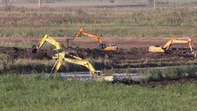 Crawler excavators at work, time lapse stock video footage