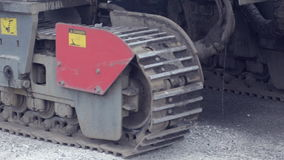 Crawler tractor close-up rides on asphalt stock video footage