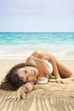 Crawling. Portrait of beautiful girl having good time on tropical beach Stock Photos