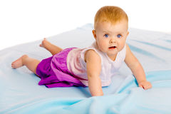 Crawling across the blue plaid baby girl Stock Images