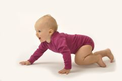 Crawling baby Stock Images