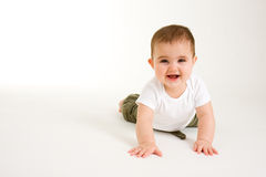 Crawling Baby 2. Baby Crawling with a big smile on her face stock photos
