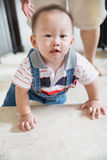 Crawling baby Stock Image