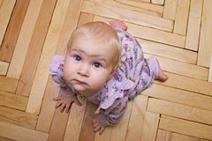 Crawling baby. Baby with funny face on all fours Royalty Free Stock Images