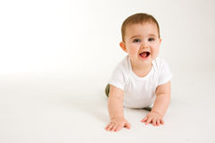 Crawling Baby. Baby Crawling with a big smile on her face royalty free stock image