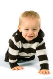 Crawling baby boy. Bright picture of crawling baby boy stock image
