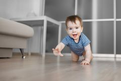 Crawling baby boy at home royalty free stock images