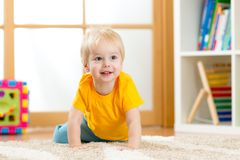 Crawling baby boy indoors Stock Photo