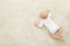 Crawling Baby on Carpet Background, Infant Kid Top View, Newborn stock image
