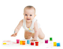 Crawling baby with a finger's paints Royalty Free Stock Photo