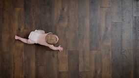 Crawling Baby on floor. Baby learning to crawl high angle view on a hardwood floor stock video