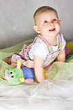 Crawling baby girl and her toy Stock Images